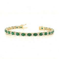 Ovales Smaragd-Tennisarmband in einer 4-Krappen-Fassung