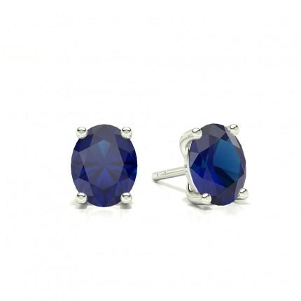 Boucle d'oreille en saphir bleu ovale serti 4 griffes