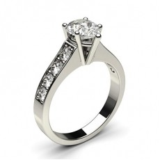 Pear Side Stone Diamond Engagement Rings
