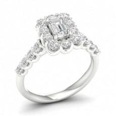 Bague de fiançailles halo de diamants et émeraude sertie griffes
