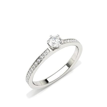 Bague de fiançailles diamant pierre latérale serti griffes